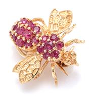 Sale 9083 - Lot 359 - A 14CT GOLD RUBY INSECT BROOCH; fashioned as bee set with 20 round cut rubies, 17.3 x 20mm, wt. 2.95g.