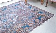 Sale 8440A - Lot 46 - A hare & bird motif rug with central medallions in blues and browns,  worn, 142 x 218cm