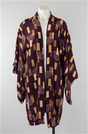 Sale 8740F - Lot 155 - A knee-length kimono, presumed silk and printed with geometric browns and taupes against a purple ground