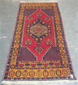 Sale 9188 - Lot 1363 - Iranian tribal rug on red ground (222 x 115cm)
