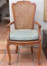 Sale 8550H - Lot 207 - A French Louis style cane back elbow chair with carved floral decoration to top rail and seat with green corduroy cushion, H 116cm