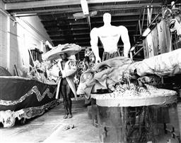 Sale 9082A - Lot 5006 - Malcom Cole, Aboriginal Representation float under construction for the Sydney Gay and Lesbian Mardi Gras Parade (1988), 25 x 20 cm,...