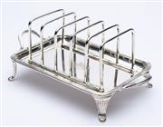 Sale 8912H - Lot 51 - Scottish silver toast rack by R&W Sorley, hallmarked 1873 GLasgow with family crest Le Bon Temps Viendra, length 19.5 , Height 8cm