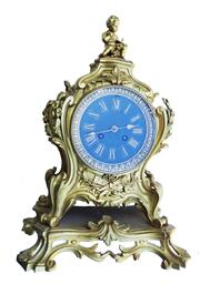 Sale 8980J - Lot 70 - Antique French gilt bronze rococo style mantle clock on fixed scroll base with key and pendulum, missing the bell / gong.  Overall H...