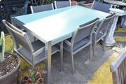 Sale 8550 - Lot 1385 - Modern Metal Seven Piece Outdoor Setting incl. Composite Form Insert Top Table & Six Chairs with Mesh Back & Seat