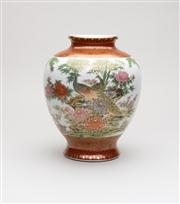 Sale 8716A - Lot 81 - A vintage Japanese Kutani porcelain vase, The wide central panel decorated with two peacocks amidst abundant florals and bamboo, the...