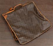 Sale 8871H - Lot 87 - A vintage French Louis Vuitton garment/suit travel bag, with some wear/scuffs to trim and handles. Length 120cm x Width 60cm