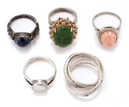 Sale 9107J - Lot 362 - FIVE STONE SET RINGS; 3 silver rings set with sodalite, mother of pearl and tri ring with zirconias, total wt. 18.66g, and 2 white m...