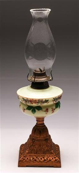 Sale 9119 - Lot 125 - A kerosene lamp with milk glass mid section (H:60cm) and another