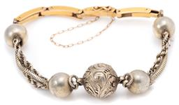 Sale 9145 - Lot 378 - AN ANTIQUE GOLD AND SILVER BRACELET; married piece front 10.5-14mm round silver balls linked by 3 rope twist and snake link chains (...
