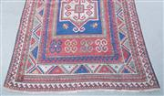 Sale 8440A - Lot 49 - A geometric Kazak gul motif carpet on red blue ground with red border, worn in places, 180 x 132cm