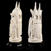 Sale 8000 - Lot 290 - A pair of Indian ivory finely carved elephants with howdah and trappings on wooden stands.