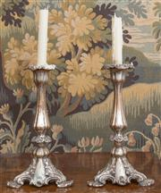 Sale 8435A - Lot 66 - A pair of Sheffield plate candle sticks with baluster stands and shell feet, H 26cm