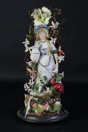 Sale 8905S - Lot 674 - A continental porcelain figure in glass dome, crack to glass, height 37cm
