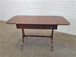 Sale 9162 - Lot 1030 - Regency Mahogany Sofa Table, with book-matched top, drop-leaves and two frieze drawers, raised on end supports with outswept feet &...