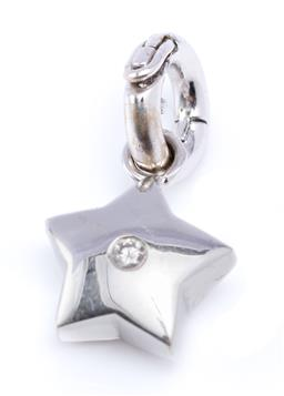 Sale 9194 - Lot 543 - AN 18CT WHITE GOLD AND DIAMOND STAR ENHANCER PENDANT; centring a round brilliant cut diamond of approx. 0.05ct, size 21 x 13mm, wt....