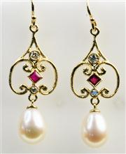 Sale 7988 - Lot 308 - A PAIR OF 9CT GOLD DROP EARRINGS; each set with a ruby, round brilliant cut diamonds and a cultured pearl drop. Length 37mm. Wt. 3.1g.