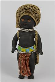Sale 8520T - Lot 18 - Aboriginal doll with sewn hair, dressed with woven twine, (crocheted) dilly bag and hat. Seed necklace and belt on red cotton with t...