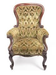 Sale 8518A - Lot 31 - An antique English mahogany armchair C: 1850. The shaped back deep buttoned in green and old gold velvet upholstery. The shaped seat...
