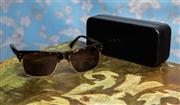 Sale 8577 - Lot 148 - A pair of Rusty tortoise shell famed sunglasses, Condition: As New with original case & box