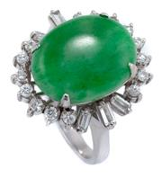 Sale 8937 - Lot 446 - A VINTAGE JADE AND DIAMOND COCKTAIL RING; featuring an oval cut cabochon jadeite jade approx. 9.5ct (15.5 x 12.28 x 5.55mm) surround...