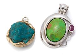 Sale 9107J - Lot 330 - TWO SILVER STONE SET PENDANTS; one set with oval cabochon green ornamental stone and an oval cut ruby, size 38 x 26mm, and a freefor...