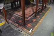 Sale 8345 - Lot 1092 - Turkish Ezine Wool Carpet, the field with repeating pattern, the border with octagons (210 x 140 cm)