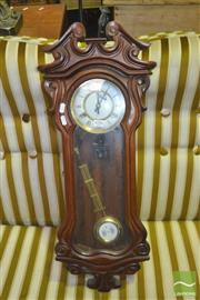 Sale 8328 - Lot 1050 - Carved Timber Wall Clock with Pendulum
