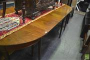 Sale 8345 - Lot 1070 - Georgian Style Victorian Mahogany Extension Dining Table with two D shaped ends & centre section with drop leaves, all raised on tap...