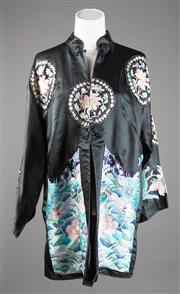 Sale 8499A - Lot 73 - A black silk long Chinese jacket with fine hand embroidered decoration of dragons, peonie flowers, pagodas etc, in coloured silks; h...