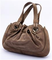 Sale 8921 - Lot 2 - A BVLGARI TAUPE SUEDE HANDBAG; with drawstring decoration and gold tone hardware, 20 x 10cm.