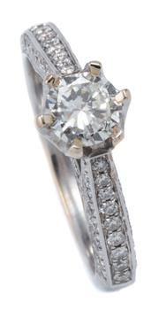 Sale 9029 - Lot 390 - AN 18CT WHITE GOLD DIAMOND RING; centring a round brilliant cut diamond of approx. 0.50ct P1, to shoulders and gallery further set w...