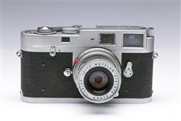 Sale 9093 - Lot 8 - A Leica M2 Camera, Fitted With A Leitz Wetzlar Lens (1:2.8/50)