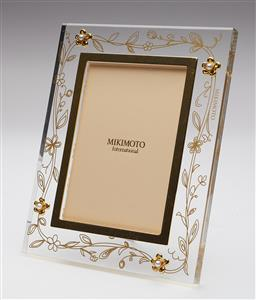 Sale 9123J - Lot 204 - A Mikimoto photo frame with trailing gilt floral decoration, each corner enhanced with a flower set with a Mikimoto cultured pearl H...