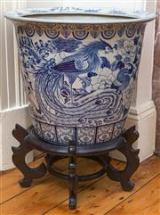 Sale 8435A - Lot 70 - A large blue and white jardinière with peacock, parrots and doves on timber stand, total H 60cm