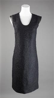 Sale 8499A - Lot 74 - A Diane von Furstenberg black wool dress with black leather cap sleeves. Size 4.