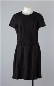 Sale 8685F - Lot 54 - A Kenzo Jungle black wool A-line dress with waist belt and capped sleeves, size 44
