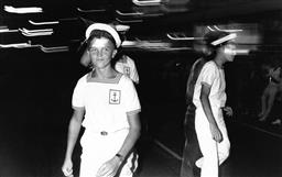Sale 9082A - Lot 5015 - Sailors, Sydney Gay and Lesbian Mardi Gras Parade, Oxford Street (1988), 24 x 15.5 cm, silver gelatin, Photographer: Gary McLean