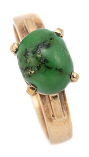Sale 9083 - Lot 534 - A VINTAGE 9CT GOLD TURQUOISE RING; claw set with an 8.6 x 6.8mm cabochon turquoise, size K, wt. 2.9g.