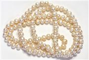 Sale 8036A - Lot 303 - A CULTURED FRESHWATER PEARL NECKLACE; bullet shape circle pearls in light pink colour.