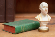 Sale 8795A - Lot 81 - An alabaster bust of Hippocrates together with a miniature book of Aristotles Masterpiece with coloured plates