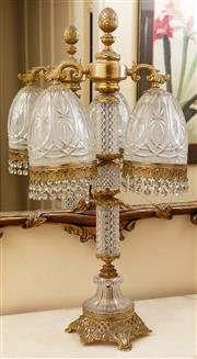 Sale 8882H - Lot 4 - A moulded cut glass and gilt brass table lamp with two hanging shades with prisms. Height 70cm