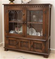 Sale 8926K - Lot 9 - An English oak book case with two leadlight and two carved panel doors, H 104 x W 101 x D30cm