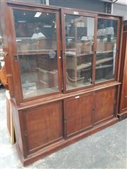 Sale 9031 - Lot 1002 - Early 20th Century Mahogany Office Bookcase, of three glass panel sliding doors, above three similar timber panel doors (H:216 W:213...