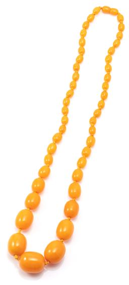 Sale 9132 - Lot 476 - A VINTAGE AMBERINE BEAD NECKLACE; graduated 9-25mm oval composite butterscotch colour beads to integrated screw clasp, length 68cm,...