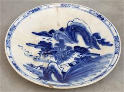 Sale 9130H - Lot 63 - A blue and white export ware ceramic charger featuring village scene, Diameter 42cm, damaged