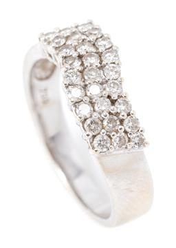 Sale 9182 - Lot 400 - AN 18CT WHITE GOLD DIAMOND RING; wave form high claw set with 27 round brilliant cut diamonds arranged in 3 rows totalling approx. 0...