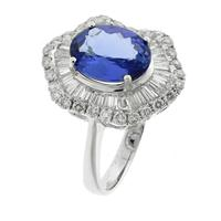 Sale 8221A - Lot 60 - 18ct White Gold Tanzanite and Diamond Cluster Ring, featuring a hexagonal mount centering an oval cut tanzanite, surrounded by taper...