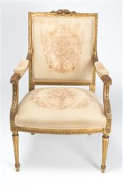 Sale 8518A - Lot 14 - An antique French giltwood neo-classic bergere armchair C: 1880. The rose carved back rail on carved uprights to acanthus carved arm...