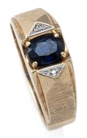 Sale 9029 - Lot 357 - A GENTS SAPPHIRE AND DIAMOND RING; 8mm wide tapering band in 10ct gold centring an oval cut blue sapphire to geometric shoulders se...